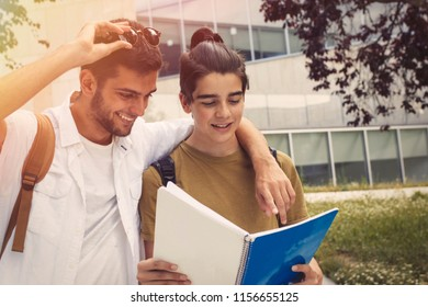 students with books at university, campus or college
