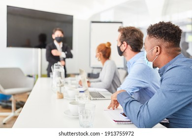 Students or business people in a seminar giving a lecture or presentation