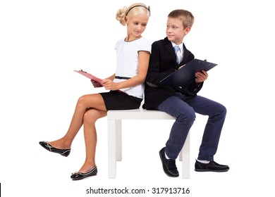 Students in business suits on white background discussing a startup, picture with depth of field and artistic blur