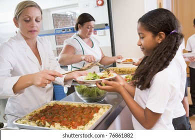 Students in cafeteria line being served lunch