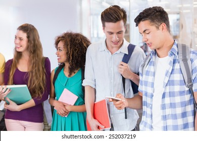 Students chatting in between classes at the college