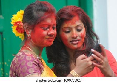 Students checking their cell phones on the occasion of Vasanta Utsav at Jorasanko Thakurbari  on March 2 in 2015 in kolkata , India