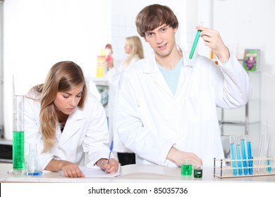 Students in a chemistry class with test tubes and other lab equipment