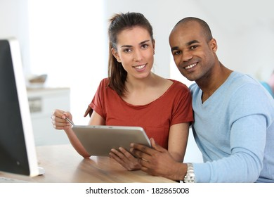Students in class connected on digital tablet