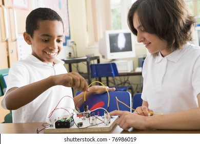Students in class with electronic project