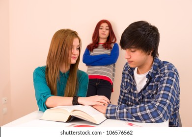 Students in classroom, jealous girl looking at a couple