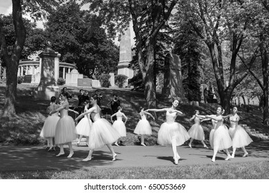 Students from l'École supérieure de ballet du Québec present a bow to the builders of Montreal at the Notre-Dame-des-Neiges Cemetery on May 28, 2017 - Montreal, Quebec