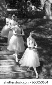 Students from l'École supérieure de ballet du Québec walking down stairs for their bow to the builders of Montreal at the Notre-Dame-des-Neiges Cemetery on May 28, 2017 - Montreal, Quebec