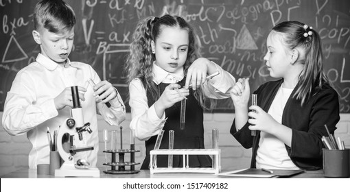 students doing experiments with microscope. Happy children. Chemistry lesson. Little kids learning chemistry in school lab. Chemistry education. Chemistry equipment. This is what we are testing today.