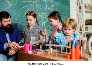 students doing science experiments with microscope in lab. school kids scientist studying science. happy children teacher. back to school. Little kids learning chemistry in school laboratory.