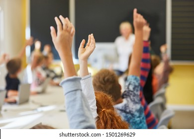 Students in elementary school lessons answer a question and register