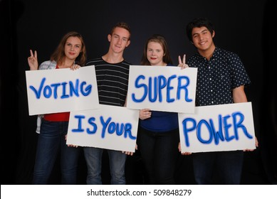 Students in Fort Myers, Florida - November 2016 -  Young Florida voters holding signs to encourage other students to vote