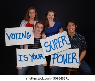 Students in Fort Myers, Florida - November 2016 - Florida's young voters holding signs to encourage other youth to vote