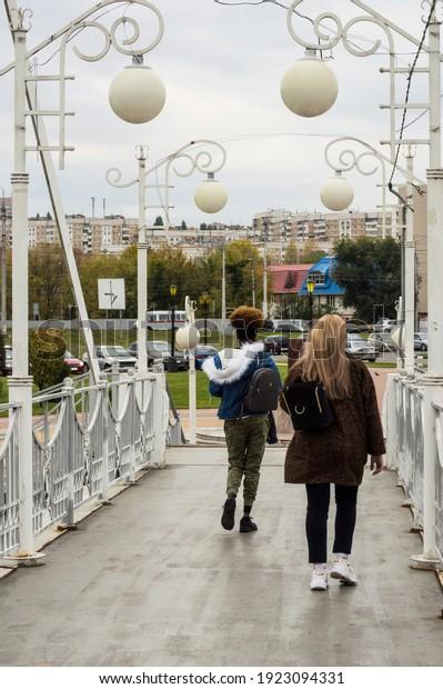 students-go-class-across-pedestrian-600w