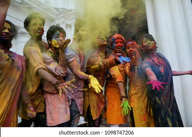 "Students having fun among themselves while covered with colorful powder called"" Abeer"" on the occasion of Vasanta Utsav at Jorasanko Thakurbari  on March 2 in 2015 in kolkata , India"