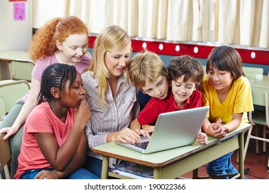 Students learning with laptop computer in elementary school class