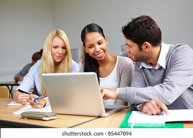 Students learning together in class in universty