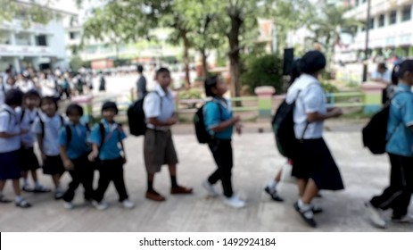 Students line up to walk home after school in an orderly manner.. Lens Blur.