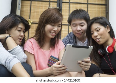 Students looking at tablet computer