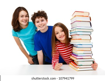 Students peeking behind pile of books on white background