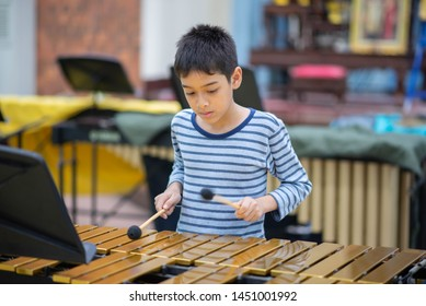 Students At Performing Arts School Playing In Band  xylophone, percussion instrument concept