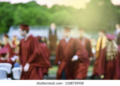 Students picking up diplomas for graduation. Soft blurred background, graduating school concept.