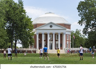 Students play in front of The Rotunda at the University of Virginia on June 26, 2017. Thomas Jefferson designed the Rotunda. Construction began in 1822 and was completed in 1826.