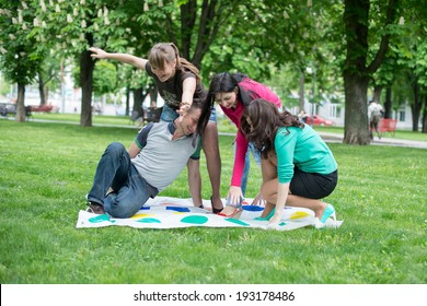 Students play a game in the park twister
