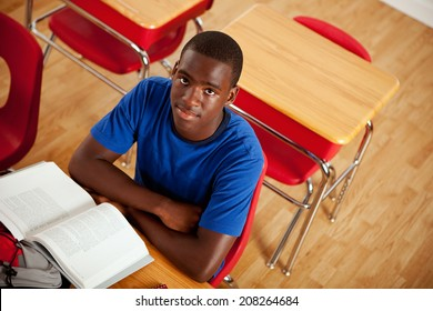 Students: Serious African American Teen Male At Desk In Class