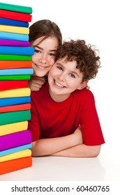 Students sitting behind pile of books on white background