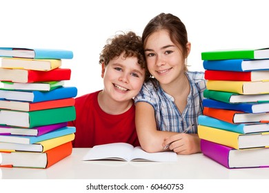 Students sitting close to pile of books on white background