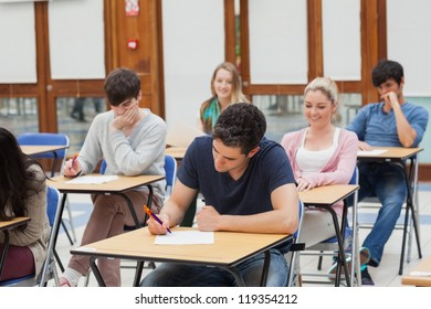 Students sitting at the exam room while writing