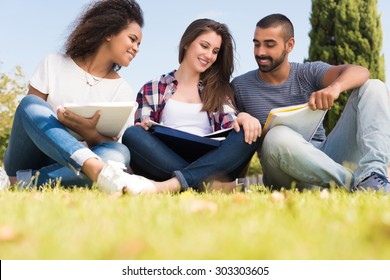 Students sitting on the grass at School Campus