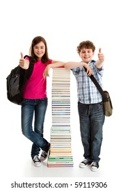 Students standing close to pile of books showing OK sign on white background