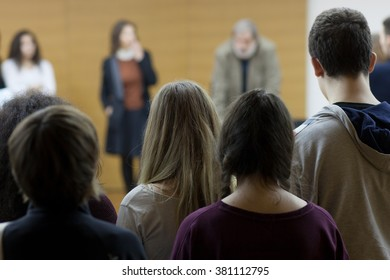 students standing at lecture