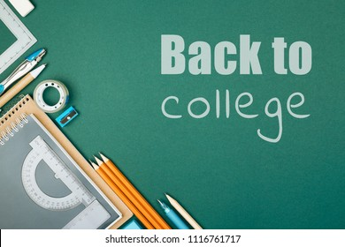 Student's stationary on green background and inscription Back To College. Preparation to college.
