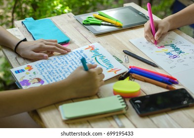 essay about environment images stock photos  vectors  shutterstock hands holding pens writing english essay and calligraphy handwriting while  doing homework