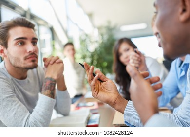 Students in team discussion in university as part of study group activity