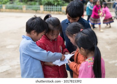 Students try to read  in the time of lunch break at Catcat village's school   in Sapa, Vietnam.This village is famous about tribals.Photo taken at Sapa,Vietnam.Date : October 16,2017.