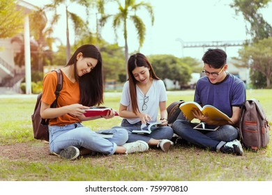 Students university asian together reading book study smiling with tablet,laptop computer at high school campus,college in summer holiday relaxation