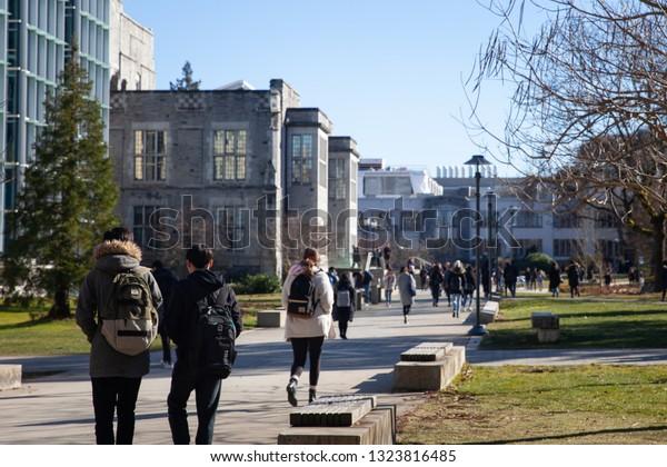 Students walk between classes on a university campus