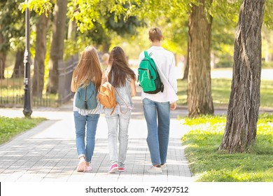 Students walking together in park