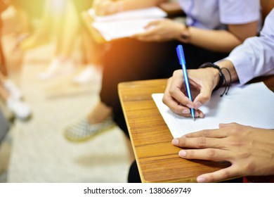 Students writing in business classroom - educational concept image of learners in a collage or university campus lecture hall or training center