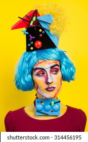 Studio art photo girls c blue hair and art makeup and positive emotions on a yellow background
