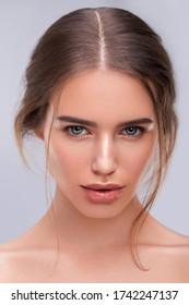 Studio beauty closeup portrait with glowing skin