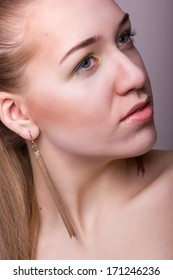 Studio beauty portrait of a beautiful young woman with makeup and hair style