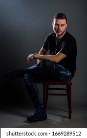 Studio body shot of a trendy young man wearing modern style clothes