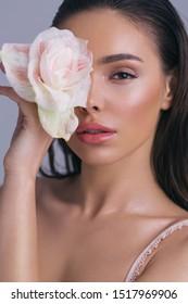 Studio closeup beauty portraits with beautiful skin and makeup