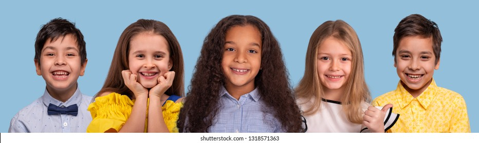 Studio  collage  of the  smiling schoolchilds of different races , isolated on blue background