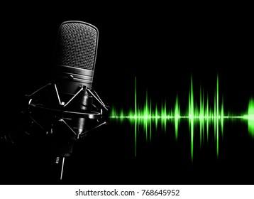 studio condenser microphone & green waveform for sound recording concept